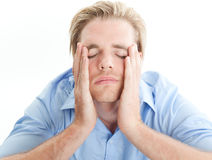 Headache. Young blond man with a headache Stock Image