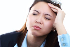 Headache. Portrait of a woman with headache Royalty Free Stock Images