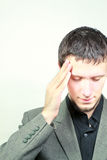 Headache. Man experiencing severe headaches and stress Royalty Free Stock Image