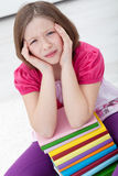 Headache. Young girl with headache sitting with lots of books Royalty Free Stock Photography