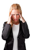 Headache. Woman suffering from an headache, holding her hands to the head Stock Image