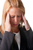 Headache. Business woman suffering from an headache, holding her hands to the head Stock Photography