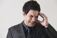 Headache. Businessman suffering from stress and a headache Stock Image