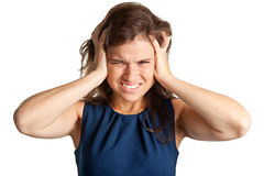 Headache. Woman suffering from an headache, holding her hands to the head Stock Photo