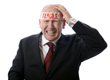 Headache. Businessman with stress or headache depicted by fragile tape isolated on white Royalty Free Stock Photography