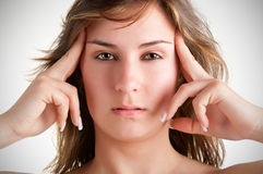 Headache. Woman suffering from an headache, holding her hands to the head Royalty Free Stock Photo