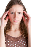 Headache. Woman suffering from an headache, holding her hands to the head, isolated in a white background Royalty Free Stock Photo