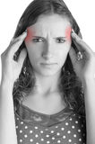 Headache. Woman suffering from an headache, holding her hands to the head, isolated in a white background Stock Photos