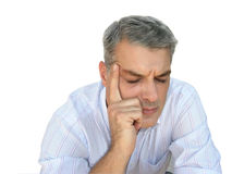 Headache. Stressed man suffering from a headache Royalty Free Stock Image