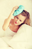 Headache. Sick woman in bed with headache Royalty Free Stock Photography