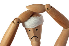 Headache. Isolated wood mannequin with headache pain hands Royalty Free Stock Photo