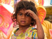 Headache. A poor little girl from India gestures as if she is having a headache Royalty Free Stock Photo