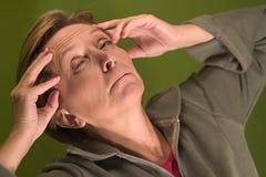 Headache. A woman with headache Stock Photography