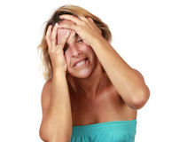 Headache. Woman suffering from a headache Royalty Free Stock Photo
