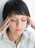 Headache. The girl is hurted with a head Stock Photos