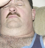 Headache. Man suffering from a powerful migraine headache Royalty Free Stock Image