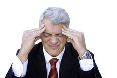 Headache. Businessman having a headache Royalty Free Stock Image