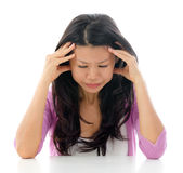Headache Asian woman. Headache Southeast Asian Chinese woman holding her head, sitting over white background Stock Photos