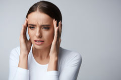 Headache. Beautiful Woman Feeling Stress And Strong Head Pain Stock Image