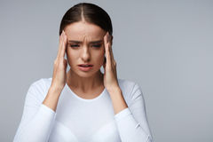 Headache. Beautiful Woman Feeling Stress And Strong Head Pain Stock Images