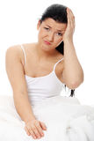 Headache in bed Royalty Free Stock Photo