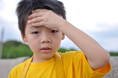 Headache boy. Asia boy with hand on forehead stock photos