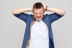 Headache. Boy have a problem or stress. Indoor shot Royalty Free Stock Images