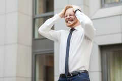 Headache. Businessman have a problem or stress. Outdoor shot Stock Image