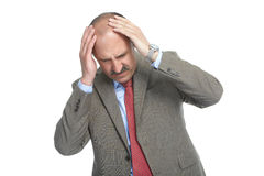 The headache. Businessman on a white background Royalty Free Stock Photo