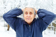 Headache & cold. Picture of an old woman having a headache Royalty Free Stock Image