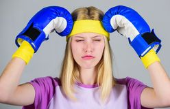Headache concept. Keep calm and get rid of headache. Beat headache. Girl boxing gloves tired to fight. Strong woman. Suffer pain. Headache remedies. Girl stock images