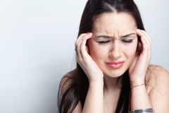 Headache concept - woman suffering a migraine royalty free stock photos