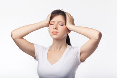 Headache concept - young woman suffering a migraine Stock Photo