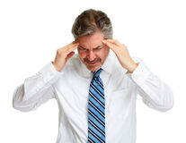 Headache. Depressed man having a headache isolated white background stock images