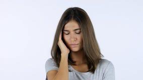 Headache, Frustrated Beautiful Girl, White Background in Studio Stock Photo