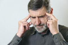 Headache. Frustrated senior man holding his head, suffering from headache stock images