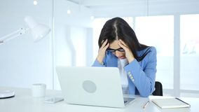 Headache and Frustration for Woman at Work. 4k , high quality Royalty Free Stock Photography