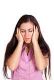 Headache. girl holds head in his hands. isolated Royalty Free Stock Image