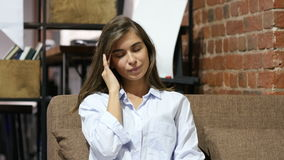Headache, Girl Sitting on Sofa in Loft Office stock video