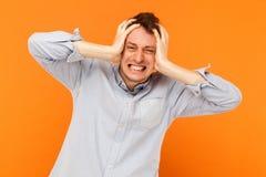 Headache. Human pain concept. Businessman sick. Studio shot, orange background Royalty Free Stock Images
