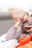 Headache and illness of a young woman (funny) Royalty Free Stock Photo