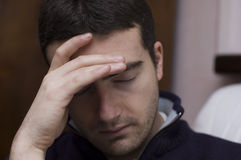 Headache man. A young man feels very bad and sick Stock Images