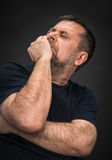 Headache. Man with face closed by hand Stock Photo