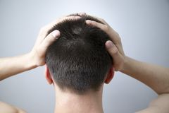 Headache of the man on gray background Royalty Free Stock Images