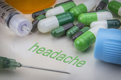 Headache, medicines and syringes as concept Stock Photo