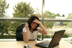 Headache at the office. Office girl with headache Royalty Free Stock Images