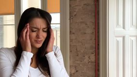 Headache pain. Beautiful woman having painful migraine. Health stock footage