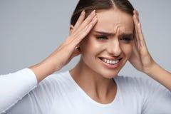 Headache Pain. Beautiful Woman Having Painful Migraine. Health Stock Photo