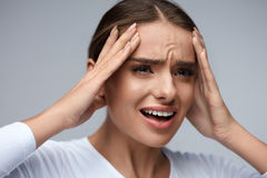 Headache Pain. Beautiful Woman With Painful Migraine, Screaming Stock Photo