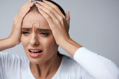Headache Pain. Beautiful Woman With Painful Migraine, Screaming Royalty Free Stock Images